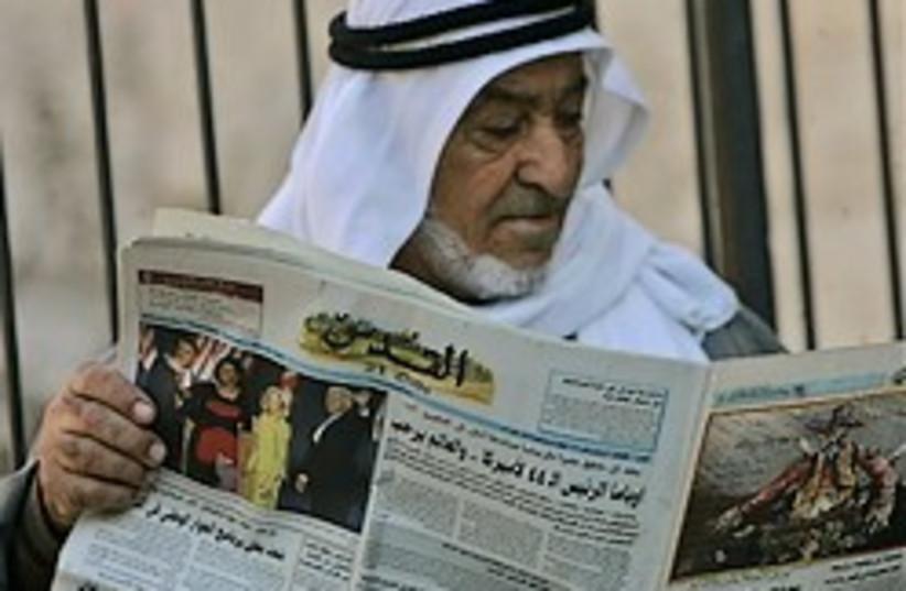 arab man reading paper 248.88 ap (photo credit: AP)