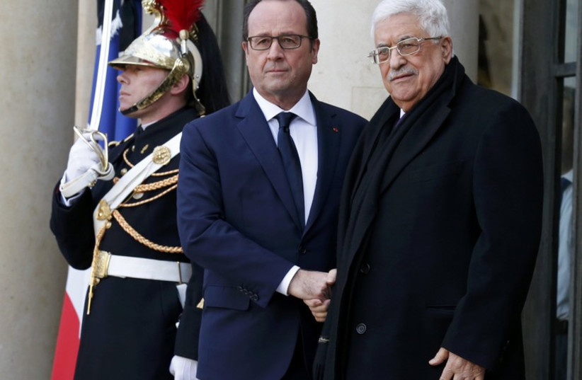French President Francois Hollande welcomes Palestinian President Mahmoud Abbas at the Elysee Palace. (photo credit: REUTERS)