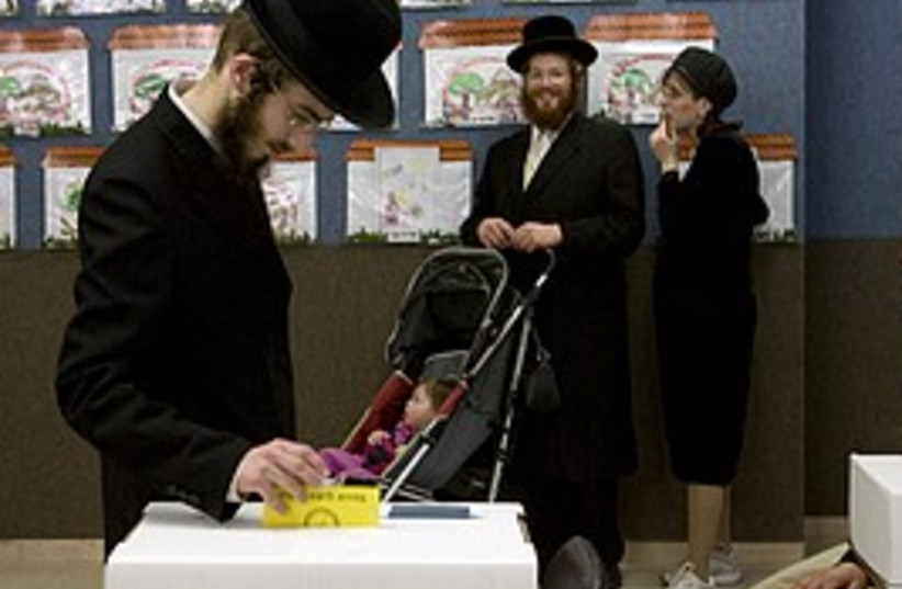 man votes in election 298.88 (photo credit: )