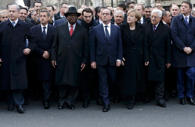 World leaders including Netanyahu and Abbas flank French Presdient Francois Hollande at Paris solidarity rally (photo credit: REUTERS)