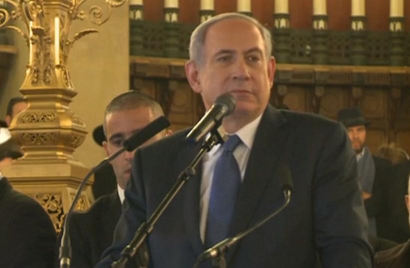 Prime Minister Benjamin Netanyahu at the Grand Synagogue in Paris, January 11, 2015 (photo credit: screenshot)