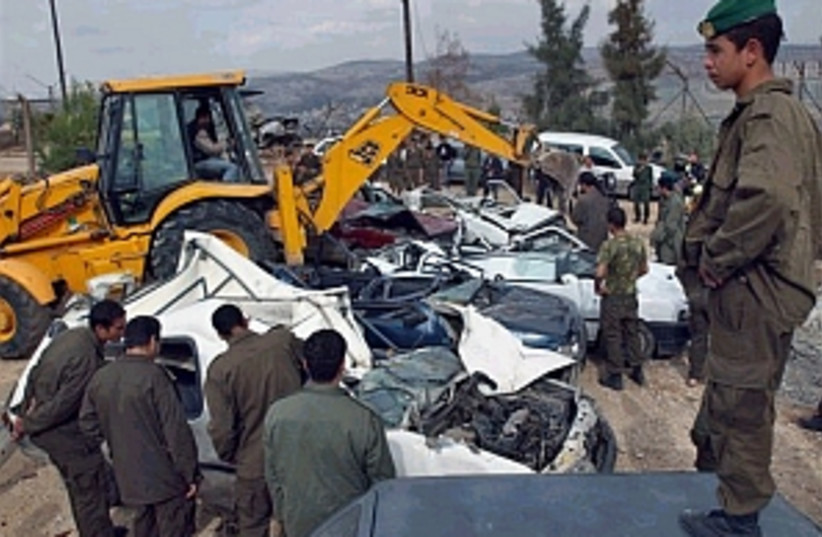 pa police destroy cars (photo credit: AP)