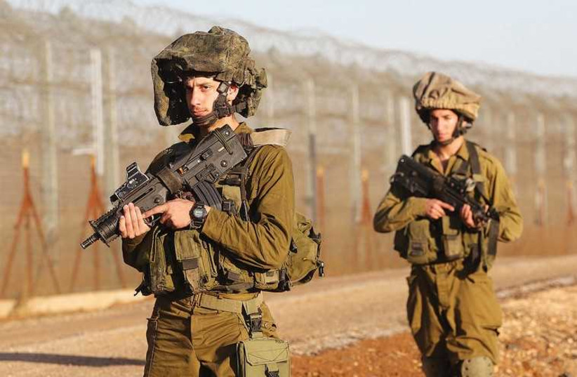 FOR SOLDIERS, long periods of waiting are accompanied by the awareness of the possibility of sudden, extreme danger. (photo credit: MARC ISRAEL SELLEM/THE JERUSALEM POST)
