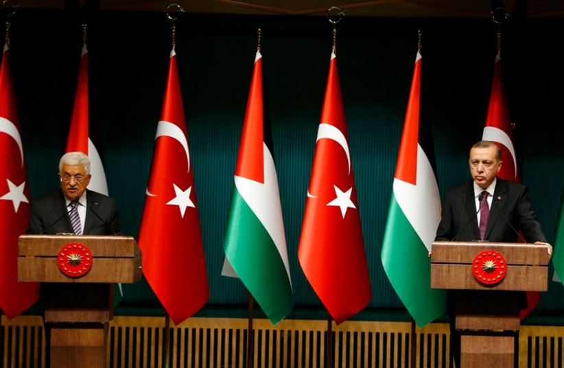 Turkey's President Tayyip Erdogan and Palestinian President Mahmoud Abbas (L) address the media at the Presidential Palace in Ankara January 12, 2015. (photo credit: REUTERS)