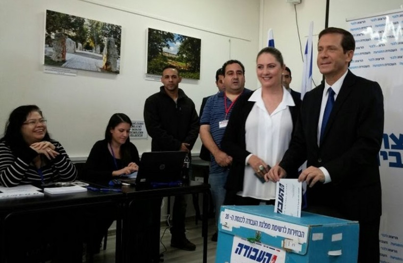 Labor Party leader Isaac Herzog casts his ballot in the primary (photo credit: COURTESY LABOR-HATNUA)