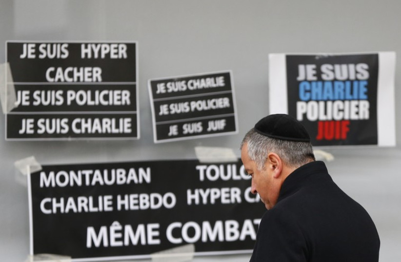 French Jewish man pays repsects to victims of terror attack (photo credit: REUTERS)