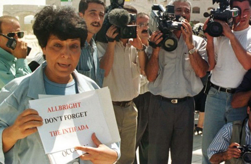 LEILA KHALED holds a banner outside the US Embassy in Jordan during a protest in 1997. (photo credit: REUTERS)