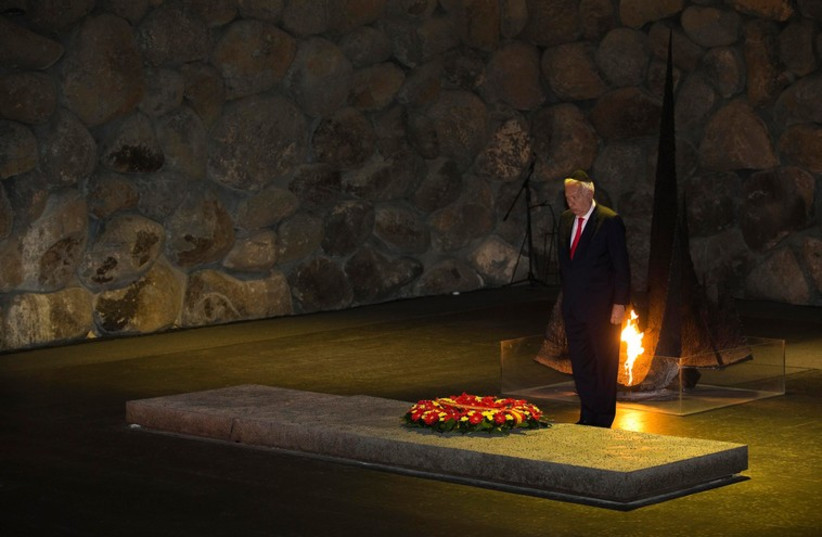 Spain's Foreign Minister Jose Manuel Garcia-Margallo observes a moment of silence during a ceremony at the Yad Vashem Holocaust memorial in Jerusalem, January 14 (photo credit: REUTERS)