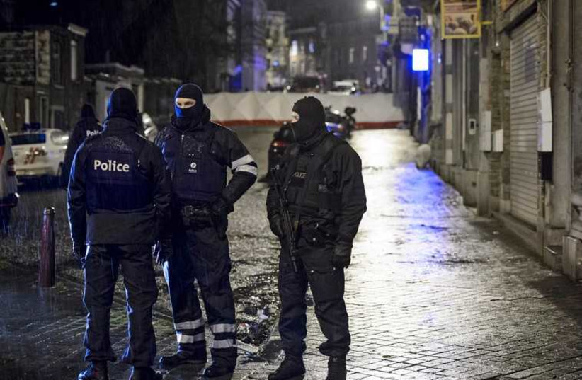 Belgian special forces police block a street in central Verviers (photo credit: REUTERS)