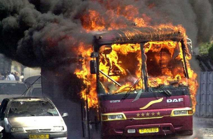 A bus burns where a car bomb exploded at Beit Lid junction near Netanya, September 9, 2001 (photo credit: REUTERS)