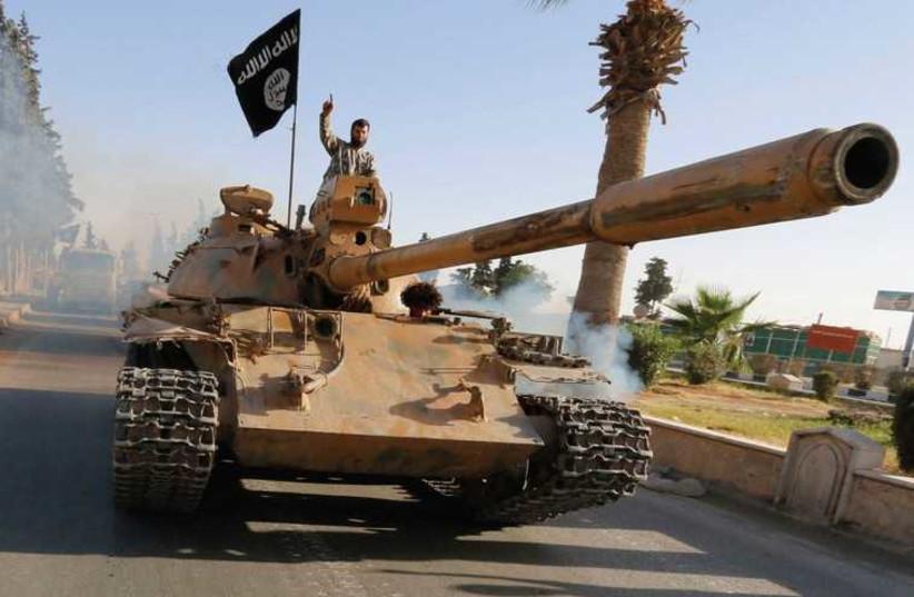 Islamic State Tank (photo credit: REUTERS)