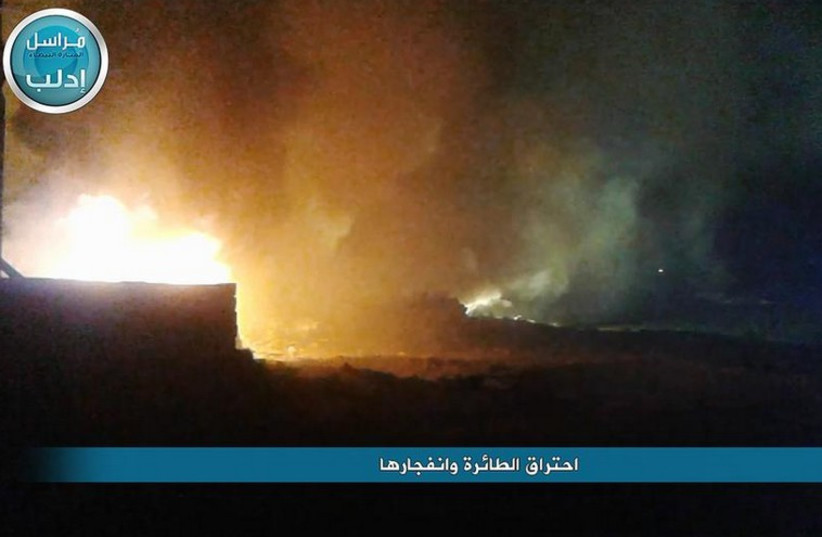 Syrian media coverage of a crashed military plane in flames (photo credit: SYRIAN MEDIA)