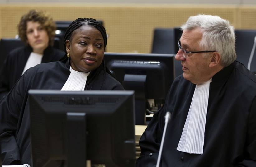 International Criminal Court prosecutor Fatou Bensouda speaks with her deputy, James Stewart, at an ICC hearing in March 2014 (photo credit: REUTERS)