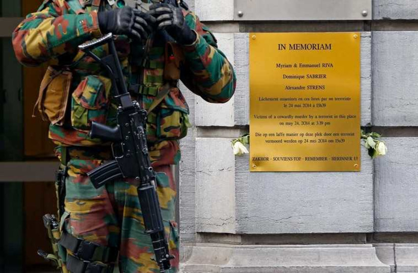 A Belgian soldier guards the entrance of the Jewish Museum in central Brussels January 18 (photo credit: REUTERS)
