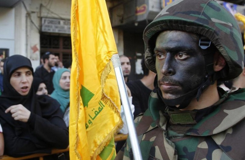 Lebanese Hezbollah supporters march during a religious procession in Nabatieh (photo credit: REUTERS)