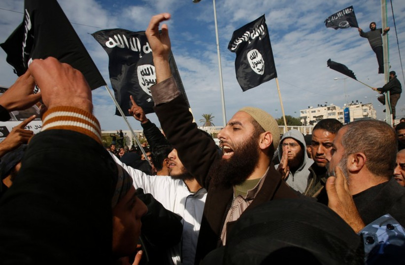 Salafists in Gaza fly ISIS ( Islamic State) flags (photo credit: REUTERS)