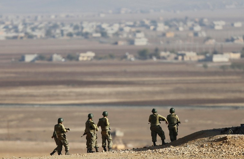TURKISH SOLDIERS stand guard on the border with Syria; the country faces threats from the Syrian Civil War. (photo credit: REUTERS)
