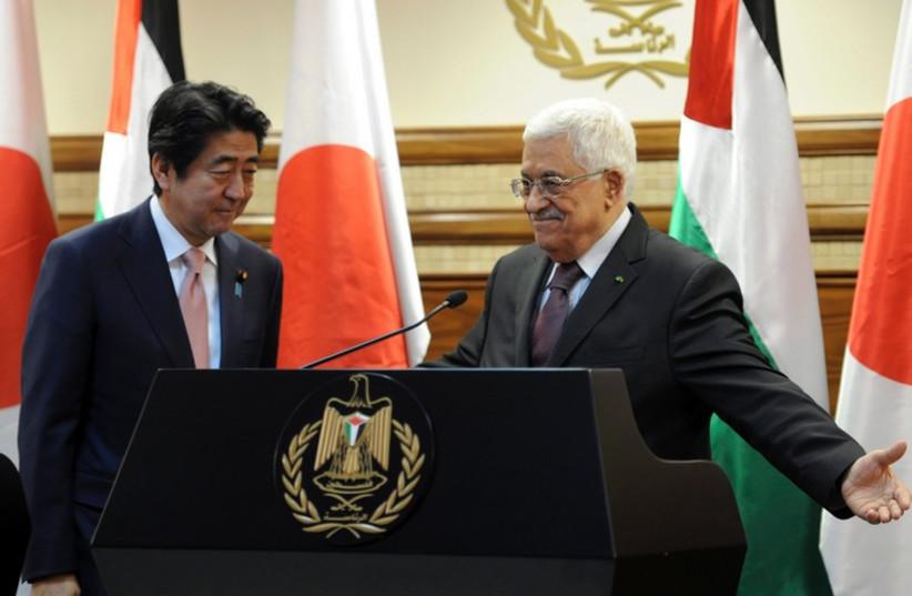 PA President Mahmoud Abbas with PM of Japan Shinzo Abe, Ramallah, January 20, 2015  (photo credit: REUTERS)