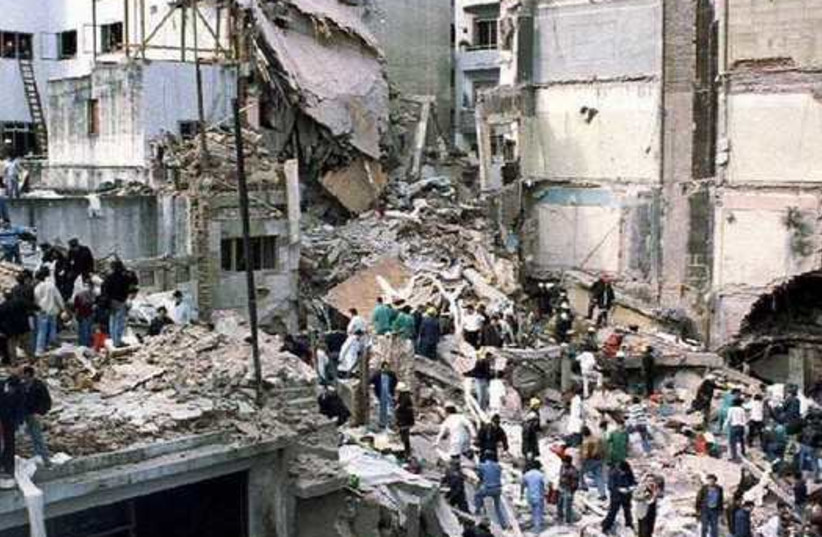 Rescue workers search for survivors and victims in the rubble left after a powerful car bomb destroyed the Buenos Aires headquarters of the Argentine Israeli Mutual Association (AMIA), in this July 18, 1994 file photo (photo credit: REUTERS)