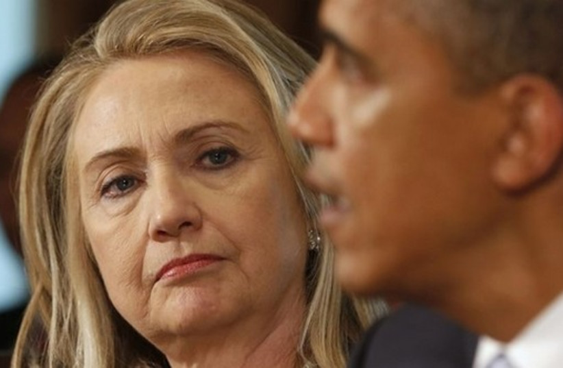 Hillary Clinton (L) and US President Barack Obama (R) (photo credit: REUTERS)