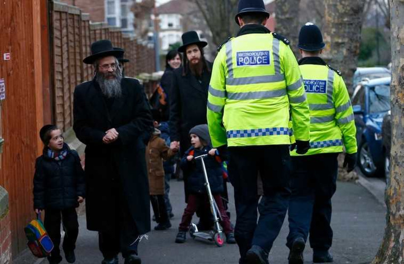 Members of the Jewish community in north London  (photo credit: REUTERS)
