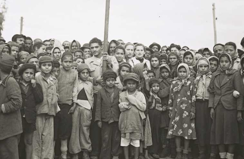 Yemenite immigrants gather for a photo at Rosh Ha'ayin, in the early years of the state. (photo credit: ILLUSTRATIVE: GPO FLICKR)