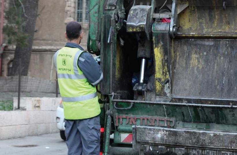 Garbage truck (photo credit: MARC ISRAEL SELLEM/THE JERUSALEM POST)