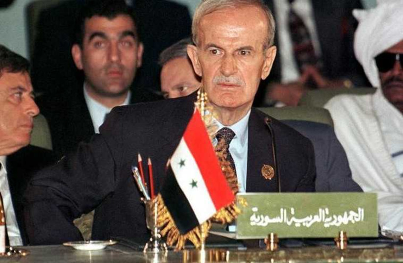 Late Syrian president Hafez Assad seen here at an Arab League summit in 1996 (photo credit: REUTERS)
