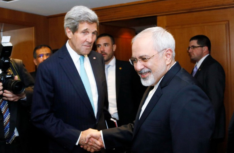 U.S. Secretary of State John Kerry shakes hands with Iranian Foreign Minister Mohammad Javad Zarif. (photo credit: REUTERS)
