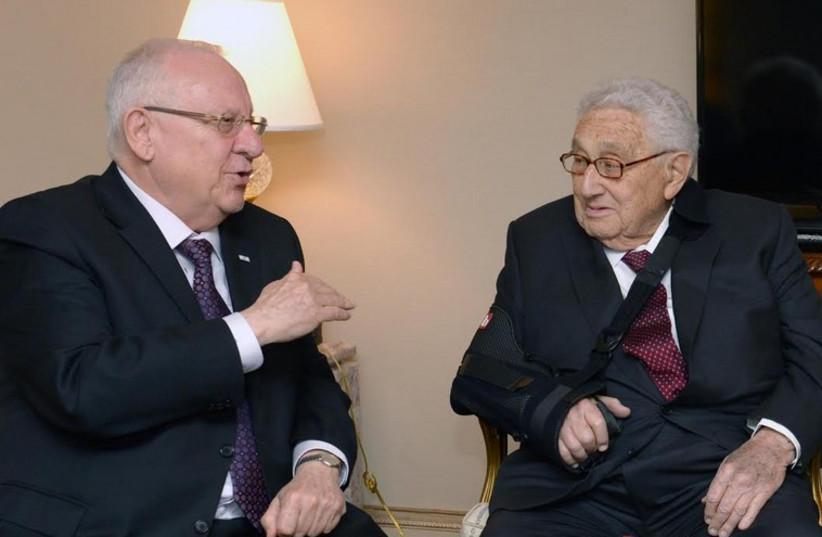 President Reuven Rivlin (L) meets former secretary of state Henry Kissinger in New York (photo credit: Mark Neiman/GPO)