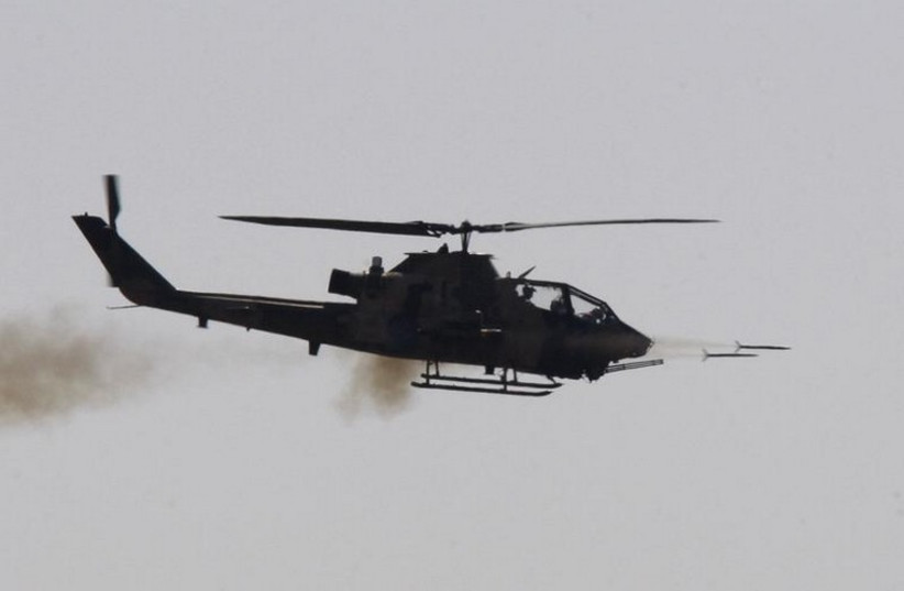 A combat Cobra helicopter fires during the EFES-2010 military exercise in Izmir  (photo credit: REUTERS)