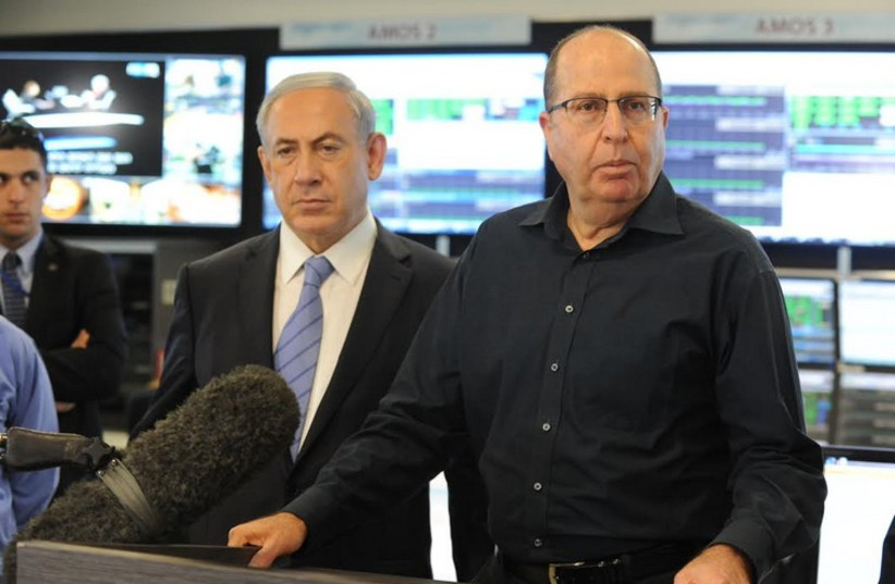 Moshe Ya'alon  and Prime Minister Benjamin Netanyahu visit Israel Aerospace Industries‏. (photo credit: AVSHALOM SASSONI)