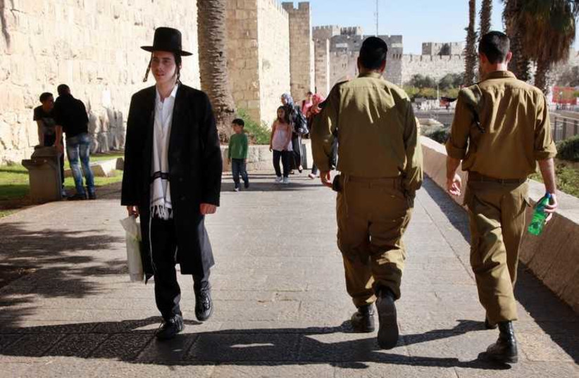 Haredi man and IDF soldiers in Jerusalem. (photo credit: MARC ISRAEL SELLEM)