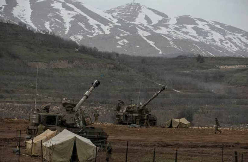 IDF soldiers near the border with Syria in the Golan Heights  (photo credit: REUTERS)