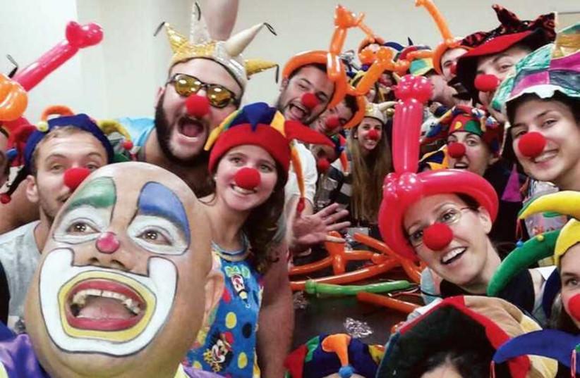 Taglit-Birthright participants with Itzik the clown at the Schneider Children's Medical Center. (photo credit: TAGLIT-BIRTHRIGHT)