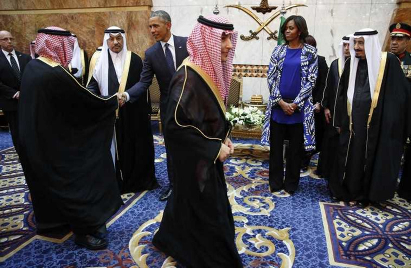 US President Barack Obama  and First Lady Michelle Obama meet members of the Saudi royal family, government officials and guests (photo credit: REUTERS)