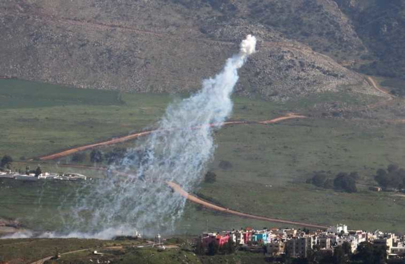 Smoke rises from shells fired from Israel over al-Wazzani area in southern Lebanon (photo credit: REUTERS)