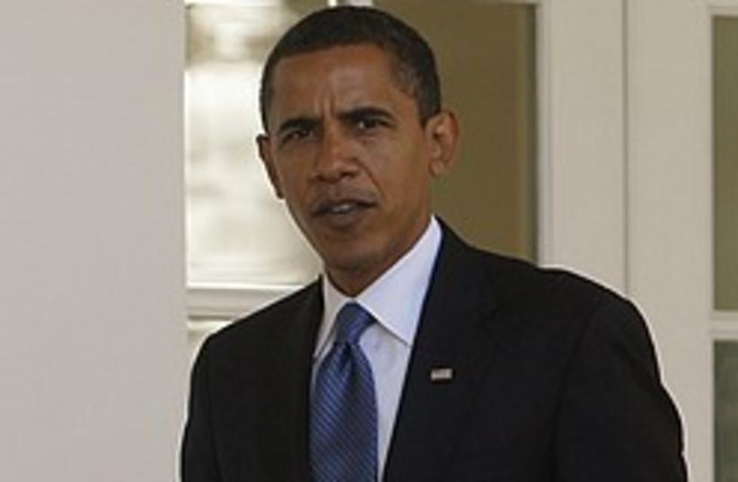 obama serious 248.88 (photo credit: AP)