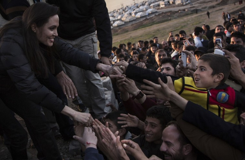 United Nations High Commissioner for Refugees (UNHCR) Special Envoy Angelina Jolie meets members of the Yazidi minority in Khanke internally displaced person (IDP) Camp in Dohuk, northern Iraq January 25, 2015. (photo credit: REUTERS)