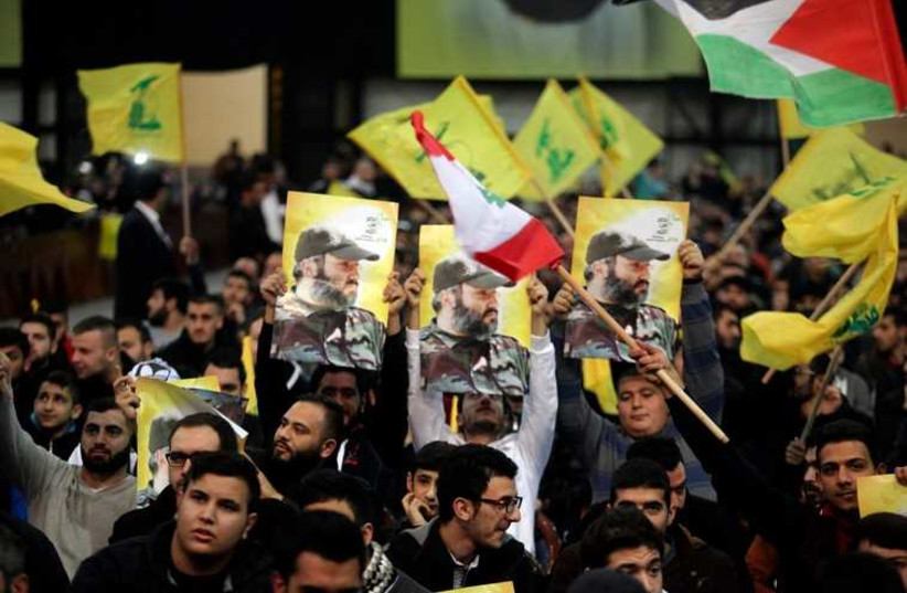 Hezbollah supporters during a televized speech by the group's leader Sayyed Hassan Nasrallah in Beirut (photo credit: REUTERS)