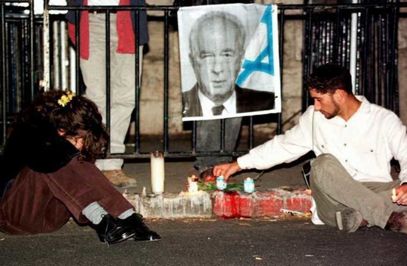 Israelis mourn the assassiniation of Prime Minister Yitzhak Rabin (photo credit: REUTERS)