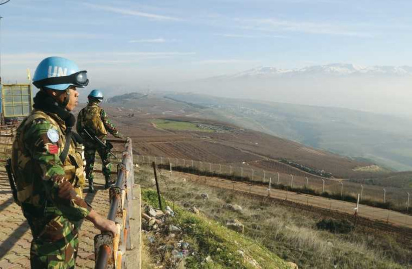 Indonesian soldiers, part of the United Nations Interim Force in Lebanon, look out over the Lebanese-Israeli border on January 19. (photo credit: REUTERS)