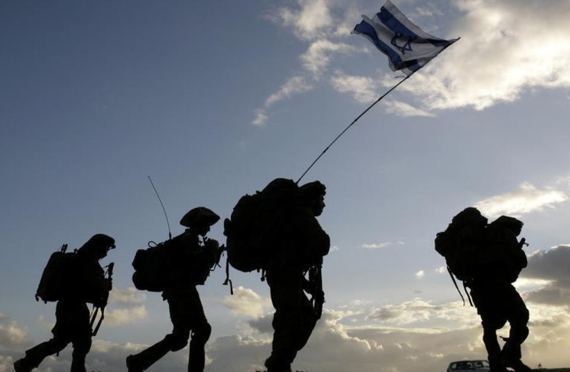 Israeli soldiers cross the Gaza border back to Israel early morning after a combat mission in Gaza (photo credit: REUTERS)