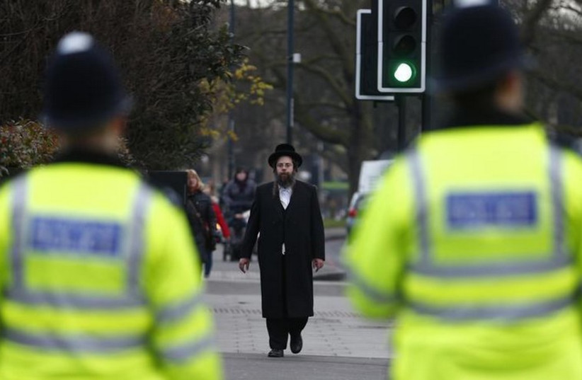 A member of the Jewish community walks in north London (photo credit: REUTERS)