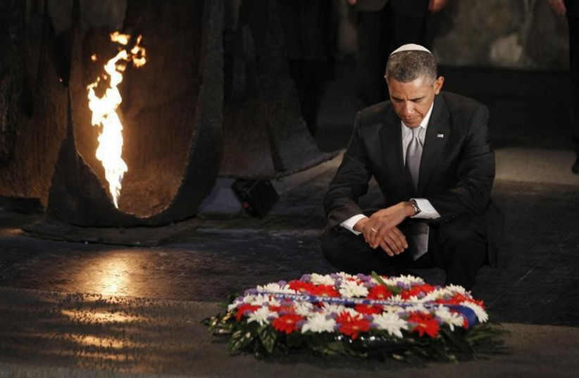 US President Barack Obama pauses for a moment as he lays a wreath at the Hall of Remembrance during his visit to Yad Vashem (photo credit: REUTERS)