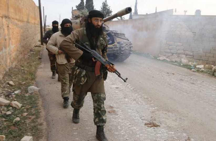 Members of al-Qaida's‏ Nusra Front [File] (photo credit: REUTERS)