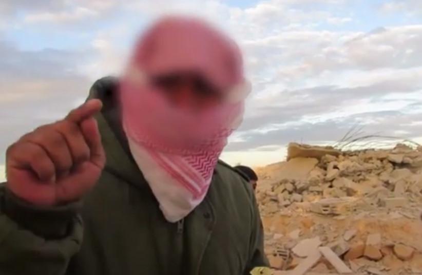 Sinai terrorist who decapitated alleged Israeli spy (photo credit: screenshot)