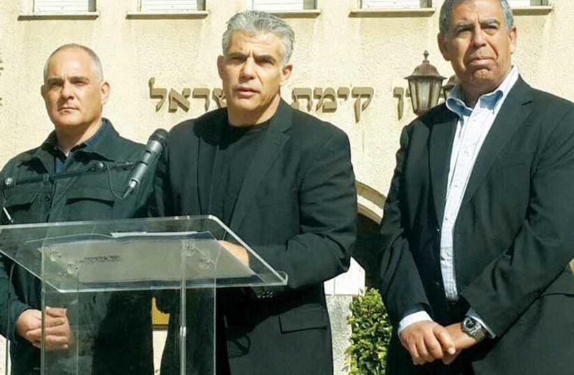 YESH ATID leader Yair Lapid speaks outside the Keren Kayemeth LeIsrael-Jewish National Fund museum in Tel Aviv (photo credit: FACEBOOK)