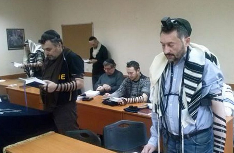 Jews pray in the synagogue in Donetsk (photo credit: DONETSK JEWISH COMMUNITY)