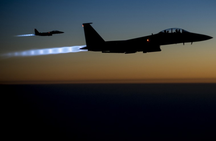 A pair of US Air Force F-15E Strike Eagles fly over northern Iraq after conducting airstrikes in Syria (photo credit: REUTERS)